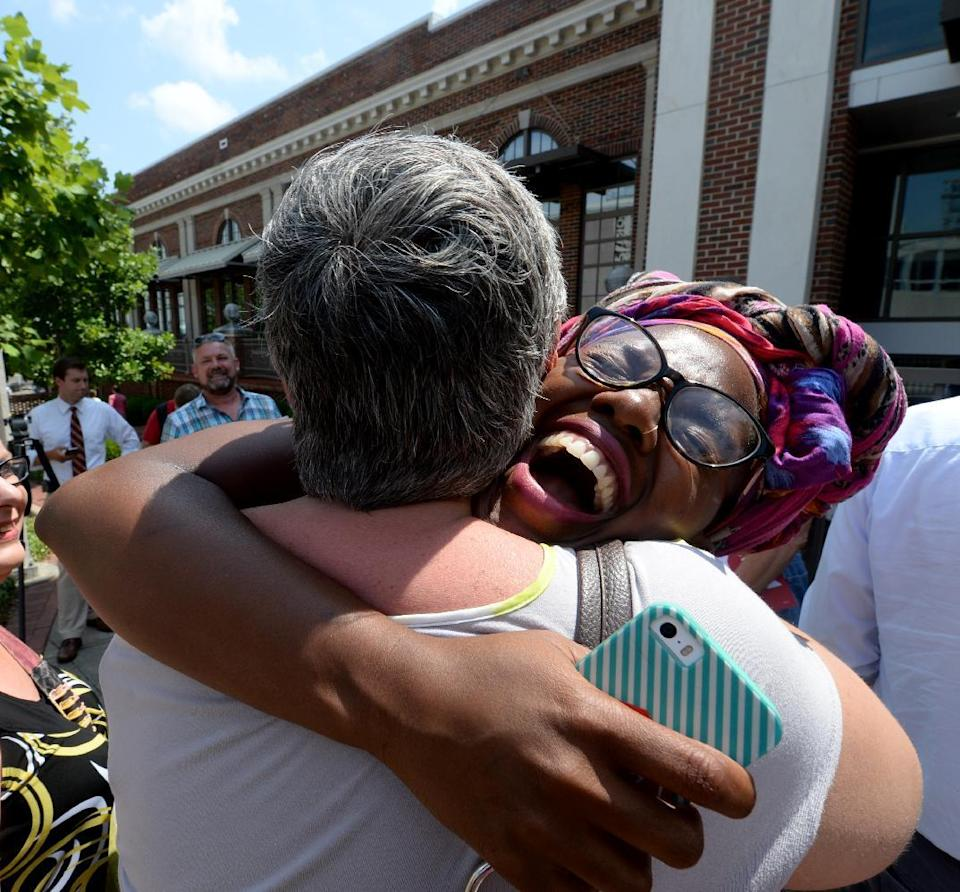 Jessica Dent, left, and Tori Sisson embrace outside the Montgomery County Probate Office celebrating the U.S. Supreme Court's decision that sex...