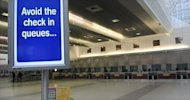 A sign above a self check-in machine at Britain&#39;s Manchester Airport in 2010. The airport has launched an urgent investigation after an 11-year-old boy managed to slip through security and fly to Rome without a passport or ticket