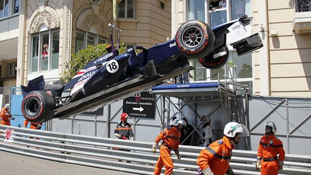 Williams Formula One driver Pastor Maldonado of Venezuela has his car winched away after he crashed it during the third practice session of the Monaco F1 Grand Prix May 26, 2012.