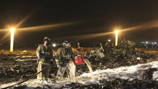 In this photo provided by Russian Emergency Situations Ministry, fire fighters and rescuers work at the crash site of a Russian passenger airliner near Kazan, the capital of the Tatarstan republic, about 720 kilometers (450 miles) east of Moscow, Sunday, Nov. 17, 2013. A Russian passenger airliner crashed Sunday night while trying to land at the airport in the city of Kazan, killing all people aboard, officials said. The Boeing 737 belonging to Tatarstan Airlines crashed an hour after taking off from Moscow. There were no immediate indications of the cause. (AP Photo/Russian Emergency Situations Ministry)