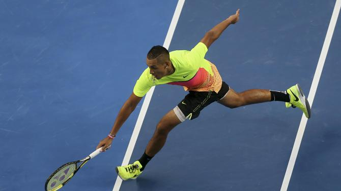 Nick Kyrgios of Australia stretches to hit a return against Andreas Seppi of Italy around the net during their men's singles fourth round match at the Australian Open 2015 tennis tournament in Melbourne