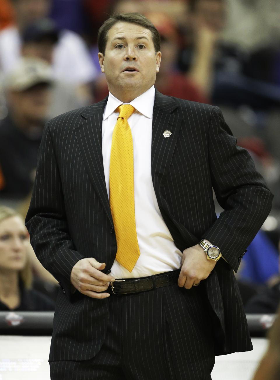 Oklahoma State head coach Travis Ford watches his team during the first half of an NCAA college basketball game against Baylor in the Big 12 tournament on Thursday, March 14, 2013, in Kansas City, Mo. (AP Photo/Orlin Wagner)