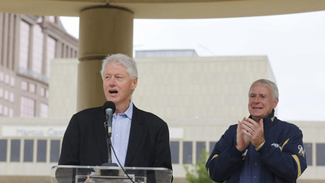 Former President Bill Clinton, left, speaks on behalf of Democratic candidate for Wisconsin Gov. Tom Barrett, right, at a recall election rally Friday, June 1, 2012, in Milwaukee. Clinton urged hundreds of Wisconsin Democrats to vote out Republican Gov. Scott Walker in next week's recall election because he refused to govern through compromise and honest negotiation.  (AP Photo/Jeffrey Phelps)