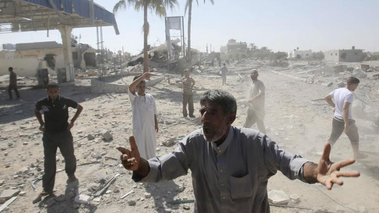 A Palestinian man reacts upon seeing destruction in the east of Khan Younis