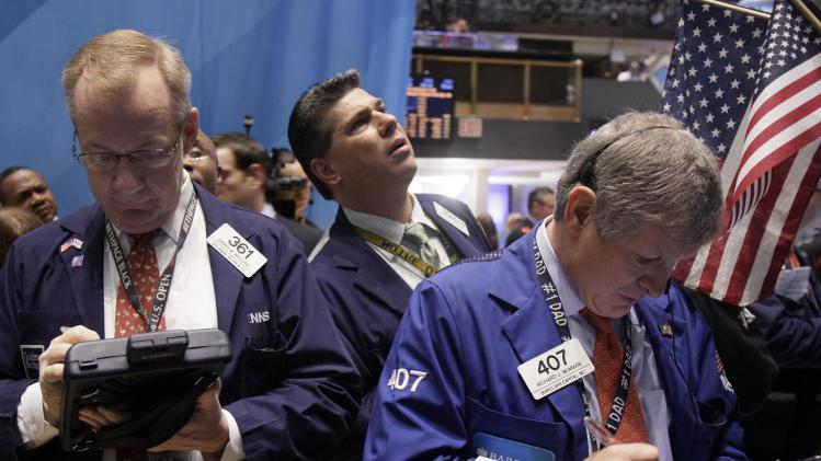 Traders Dennis Maguire, left, and Richard Newman, right, work on the floor of the New York Stock Exchange Thursday, Nov. 3, 2011. Stocks rose in early trading Thursday as hopes grow that a plan to tackle the European debt crisis will survive. (AP Photo/Richard Drew)