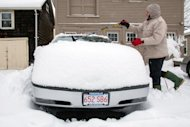 <p>A resident in Greenfield, Massachusetts clears snow off his car December 27, 2012. The US northeast was battered by heavy snow and strong winds as a powerful storm carved a violent arc across several states, killing more than a dozen people and snarling holiday travel.</p>