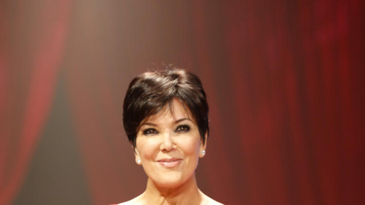 Kris Jenner walks the runway at the Red Dress Collection 2013 Fashion Show, on Wednesday, Feb. 6, 2013 in New York. (Photo by John Minchillo/Invision/AP)
