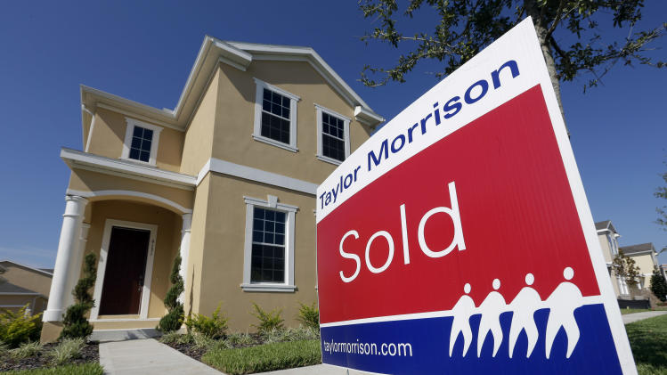"In this Wednesday, Sept. 26, 2012,  photo a""sold"" sign sits outside a new home at the Winthrop subdivision in Riverview, Fla. Average U.S. rates on fixed mortgages fell to fresh record lows for the second straight week. The declines suggest the Federal Reserve's stimulus efforts are having an impact. (AP Photo/Chris O'Meara)"
