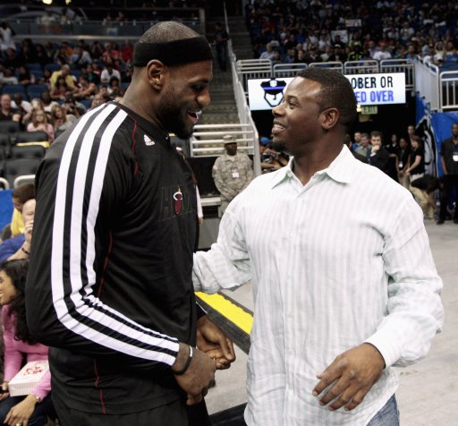 Miami Heat's LeBron James talks with retired baseball player Ken Griffey Jr. as the Heat prepare to play the Orlando Magic in a NBA basketball game in Orlando, Florida