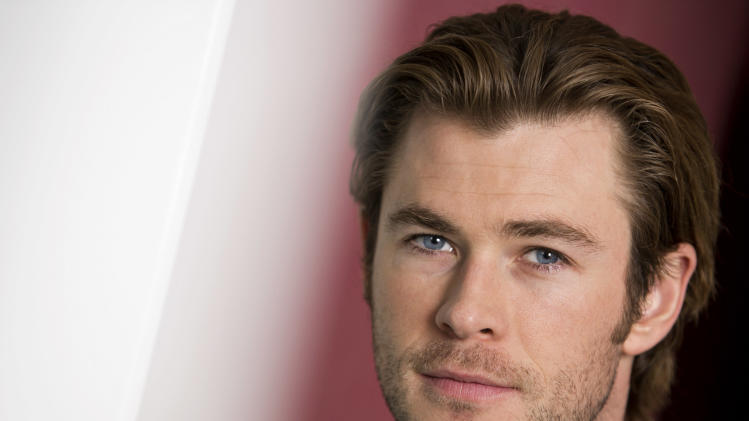 "In this Tuesday, Nov. 5, 2013 photo, Australian actor and star, Chris Hemsworth, of the upcoming film ""Thor: The Dark World,"" poses for a portrait, in New York. Overseas, Disney's movie earned an impressive $109.4 million when it opened internationally last weekend. The Marvel sequel releases in theaters in the US on Friday, Nov. 8, 2013. (Photo by Brian Ach/Invision/AP)"