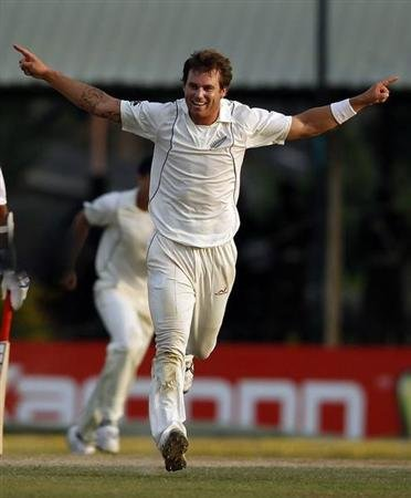 New Zealand's Bracewell celebrates taking the wicket of Sri Lanka's captain Jayawardene during the fourth day of second and final test cricket match in Colombo