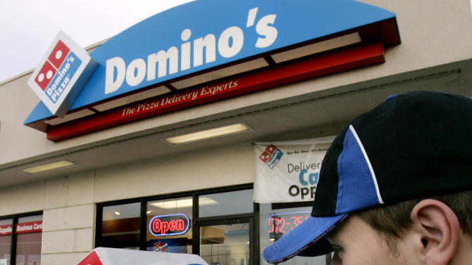 "FILE - In this Feb. 21, 2007 file photo, Domino's Pizza delivery person Brandon Christensen plugs in the company sign atop his car in Sandy, Utah. The pizza delivery chain on Monday, June 16, 2014 plans to introduce a function on its mobile app that lets customers place orders by speaking with a computer-generated voice named ""Dom."" (AP Photo/Douglas C. Pizac, File)"