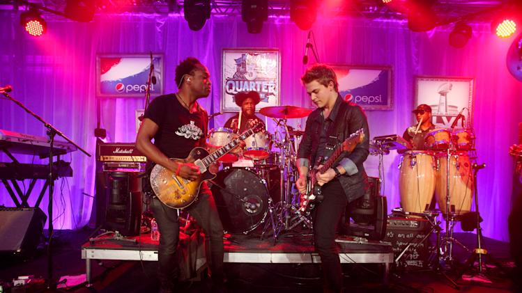 IMAGE DISTRIBUTED FOR PEPSI - Captain Kirk Douglas and ?uestlove of The Roots, Hunter Hayes and F. Knuckles of The Roots perform at the Pepsi 5th Quarter in the French Quarter Post Super Bowl Party, on Sunday, Feb. 3, 2013, in New Orleans. (Photo by Barry Brecheisen/Invision for Pepsi/AP Images)
