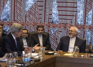 U.S. Secretary of State John Kerry and Iranian Foreign Minister Mohammad Javad Zarif are seated during a meeting at the UN Headquarters in New York