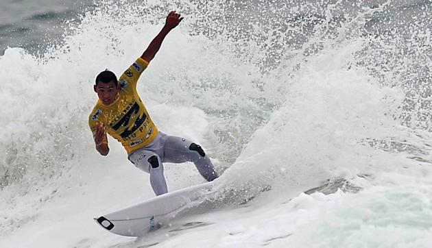 Brazilian surfer Jadson Andre competes in the Association of Surfing Professionals' men's 2012 ASP World Championship Tour at Barra da Tijuca beach in Rio de Janeiro, Brazil, on May 14, 2012.  AFP PHO