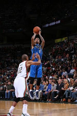 Ellis scores 18, Mavericks beat Bucks 91-83