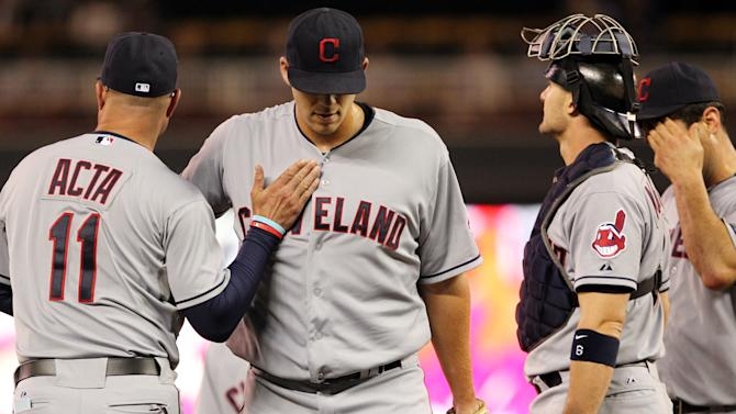 Cleveland Indians starting pitcher Justin Masterson, second from left, is taken out of the game against the Minnesota Twins by Indians manager Manny Acta (11) as catcher Lou Marson, right, looks on during the seventh inning of a baseball game, Monday, Sept. 10, 2012, in Minneapolis. Masterson had the loss and the Twins won 7-2. (AP Photo/Genevieve Ross)