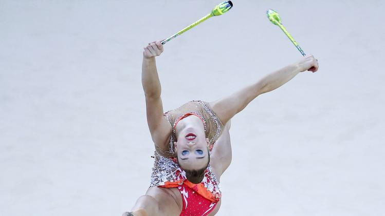 Gold medallist Bezzoubenko of Canada competes in the clubs competition of the individual apparatus final in the rhythmic gymnastics at the 2014 Commonwealth Games in Glasgow