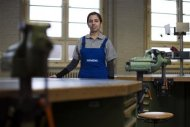 Engineering apprentice Emmanouela Miliori of Greece poses in a workshop at the Siemens training centre in Berlin February 26, 2013. REUTERS/Thomas Peter