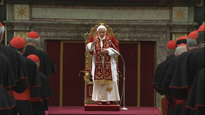 """In this image taken from video as Pope Benedict XVI deliveres his final greetings to the assembly of cardinals at the Vatican Thursday Feb. 28, 2013, before he retires in just a few hours.  Benedict urged the cardinals to work in unity and promised his """"unconditional reverence and obedience"""" to his successor in his final words to his cardinals Thursday in a poignant and powerful farewell before he becomes the first pope in 600 years to resign. (AP Photo/Vatican TV)"""