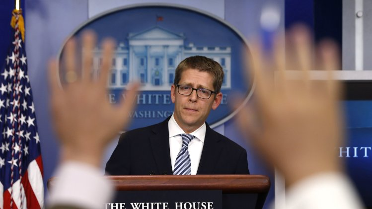 White House press secretary Carney is questioned by the press during the daily briefing at the White House in Washington