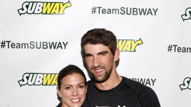 IMAGE DISTRIBUTED FOR SUBWAY - Whitney Phelps is joined by her brother, Olympic swimming champion Michael Phelps, as as she announces that she will run the ING New York City Marathon with Team SUBWAY at the Chelsea Piers Sport Center, Monday, Oct. 15, 2012 in New York. (Photo by Jason DeCrow/Invision for SUBWAY/AP Images)
