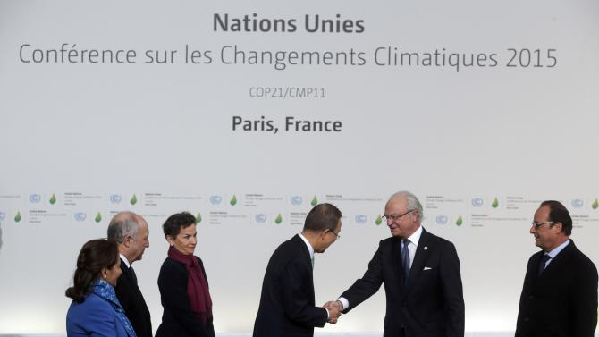 United Nations Secretary General Ban Ki-moon and French President Hollande welcome Sweden's King Carl Gustav as he arrives for the opening day of the World Climate Change Conference 2015 (COP21) at Le Bourge