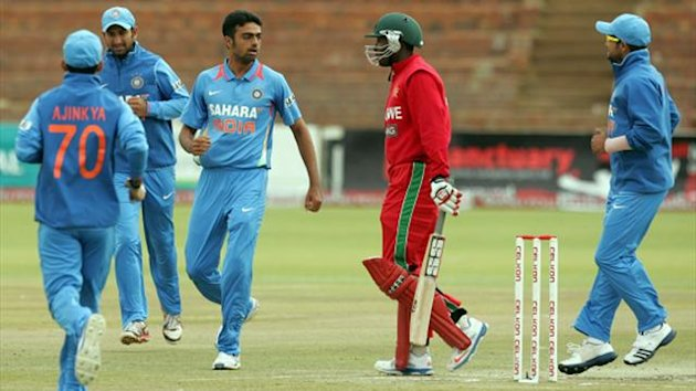 ZIMBABWE, Harare : Indian players celebrate the loss of Zimbabwe batsman Vusimuzi Sibanda during the final game of the 5 match cricket ODI series between Zimbabwe and India at the Queens Sports Club in Harare, on August 3, 2013. (AFP)