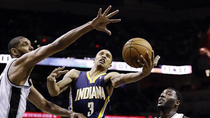 Indiana Pacers' George Hill (3) is defended by San Antonio Spurs' Tim Duncan, left, and DeJuan Blair (45) as he drives to the basket during the second quarter of an NBA basketball game, Monday, Nov. 5, 2012, in San Antonio. (AP Photo/Eric Gay)