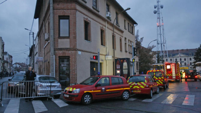 Firefighter ambulances are parked at the entrance of a street in Toulouse Wednesday March 21, 2012 where a suspect in the shooting at the Ozar Hatorah Jewish school has been spotted. French police officers have exchanged gunfire and are negotiating with a man who claims connections to al-Qaida and is suspected of killing three Jewish schoolchildren, a rabbi and three paratroopers in three attacks. (AP Photo/Remy de la Mauviniere)