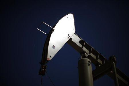 Brent down; U.S. oil up on stock, rig data in thin Thanksgiving trade