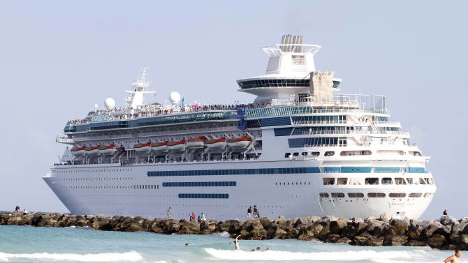 In this Monday, May 3, 2010 photo, Cruise Liner Majesty of the Seas heads out to sea in Miami Beach, Fla. Saving money on a cruise vacation requires timing and knowledge. (AP Photo/Alan Diaz)
