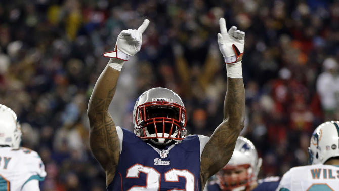 New England Patriots running back Stevan Ridley (22) celebrates his touchdown run against the Miami Dolphins during the second quarter of an NFL football game in Foxborough, Mass., Sunday, Dec. 30, 2012. (AP Photo/Elise Amendola)