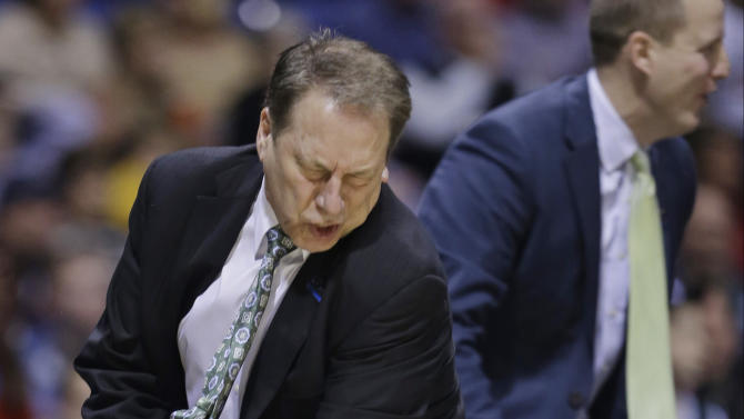 Michigan State head coach Tom Izzo reacts during the second half of a regional semifinal against Duke in the NCAA college basketball tournament, Friday, March 29, 2013, in Indianapolis. (AP Photo/Darron Cummings)