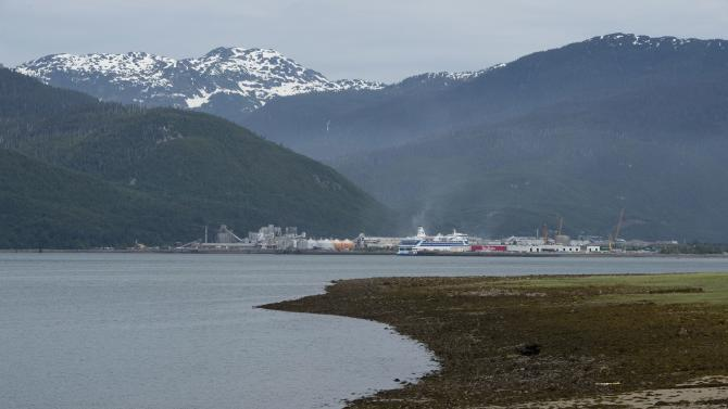 Snowcapped mountains rise above Kitimat, British Columbia, Tuesday, June 17, 2014. Canada's government on Tuesday approved a controversial pipeline proposal that would bring oil to the Pacific Coast for shipment to Asia, a major step in the country's efforts to diversify its oil exports if it can overcome fierce opposition from environmental and aboriginal groups. Enbridge's Northern Gateway project would transport 525,000 barrels of oil a day from Alberta's oil sands to the Pacific to deliver oil to Asia, mainly energy-hungry China. About 220 large oil tankers a year would visit the Pacific coast town of Kitimat and opponents fear pipeline leaks and a potential tanker spill on the pristine Pacific coast. (AP Photo/The Canadian Press, Jonathan Hayward)
