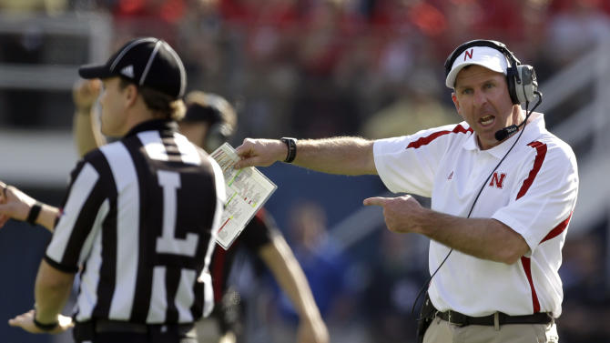Nebraska head coach Bo Pelini, right, shouts at line judge Walt Colman, left, during the first half of the Capital One Bowl NCAA football game against Georgia, Tuesday, Jan. 1, 2013, in Orlando, Fla. (AP Photo/John Raoux)