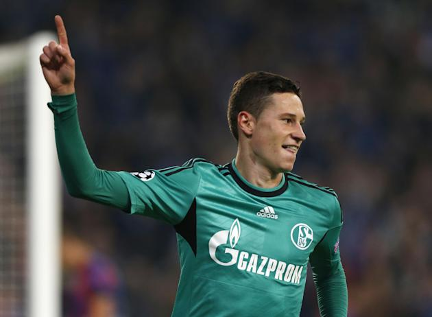 Schalke's Julian Draxler celebrates his side's third goal during the Champions League group E soccer match between Schalke 04 and Steaua Bucharest in Gelsenkirchen, Germany, Wednesday, Sept. 18, 2013