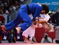 Hungary's Eva Csernoviczki (white) competes with Japan's Tomoko Fukumi during their women's -48 kgs contest bronze medal match of the judo event at the London 2012 Olympic Games
