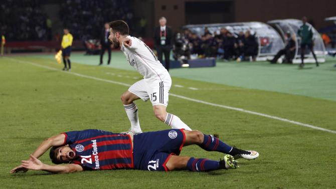 San Lorenzo's Mas fights for the ball with Real Madrid's Carvajal during their Club World Cup final soccer match at the Marrakech stadium