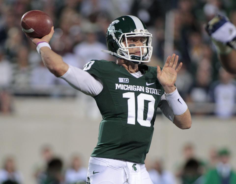 Michigan State quarterback Andrew Maxwell throws a pass during the first quarter of an NCAA college football game against Notre Dame, Saturday, Sept. 15, 2012, in East Lansing, Mich. (AP Photo/Al Goldis)