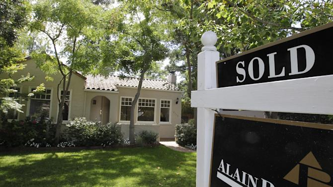This Tuesday, Aug. 21, 2012, photo, shows an exterior view of a home sold in Palo Alto, Calif.  U.S. sales of previously occupied homes jumped in August to the highest level in more than two years, adding momentum to the housing recovery. The National Association of Realtors says sales rose 7.8 percent to a seasonally adjusted annual rate of 4.82 million. That's the most since May 2010, when sales were fueled by a federal home-buying tax credit. (AP Photo/Paul Sakuma)