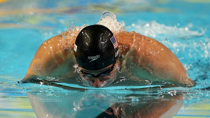 Ryan Lochte of U.S. competes in the men's 100 meters individual medley semifinal during the FINA Short Course Swimming World Championships at the Sinan Erdem Arena in Istanbul, Saturday, Dec. 15, 2012. Lochte sets a new world record with 50''71. (AP Photo / Thanassis Stavrakis)