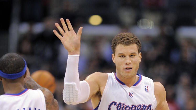 Los Angeles Clippers forward Blake Griffin, right, is congratulated by guard Mo Williams after sinking a basket during the second half of their NBA basketball game against the Dallas Mavericks, Wednesday, Jan. 18, 2012, in Los Angeles. The Clippers won 91-89.  (AP Photo/Mark J. Terrill)