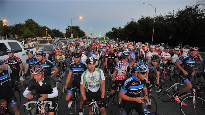 Riders meet up before the start of the annual Climb to Kaiser ride, Saturday morning, June 30, 2012 near Fresno, Calif. The ride, covering 155 miles, with a 13,500 elevation gain is rated as one of the 10 toughest rides in America by Bicycling Magazine. (AP Photo/The Fresno Bee, John Walker)