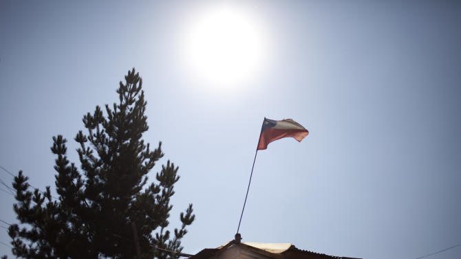 "A Chilean flag waves on top of a house at the San Pablo shanty town in Santiago, Chile, Wednesday, Jan. 23, 2013.  European, Latin American and Caribbean leaders gathering for this weekend's economic summit will likely see only one side of Chile _ the polished, upscale country where tourists and investors stay in five-star hotels in a sparklingly clean financial district nicknamed ""Sanhattan,"" well away from Santiago's slums. (AP Photo/Victor R. Caivano)"