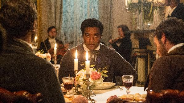 "This film publicity image released by Fox Searchlight shows Chiwetel Ejiofor in a scene from ""12 Years A Slave."" The film received 13 nominations for the Broadcast Film Critics Association's 19th Annual Critics' Choice Movie Awards airing Jan. 16, 2014 on the CW network. (AP Photo/Fox Searchlight Films, Jaap Buitendijk)"
