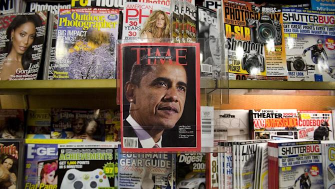 FILE - This Nov. 19, 2008 file photo shows President Barack Obama featured in a special issue of Time Magazine on a New York newsstand. Time Warner Inc. on Wednesday March 6, 2013 said that it will spin off the magazine unit behind Time, Sports Illustrated and People into a separate, publicly traded company by the end of the year. (AP Photo/Mark Lennihan, File)