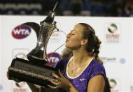 Petra Kvitova of the Czech Republic kisses the winner&#39;s trophy after her women&#39;s singles final match against Sara Errani of Italy during the WTA Dubai Tennis Championships, February 23, 2013. REUTERS/Mohammed Salem