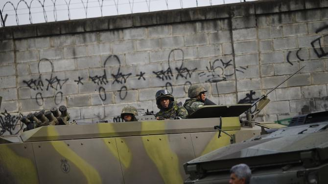Brazil's Navy soldiers patrol the Mare slums complex ahead of Sunday's election runoff in Rio de Janeiro