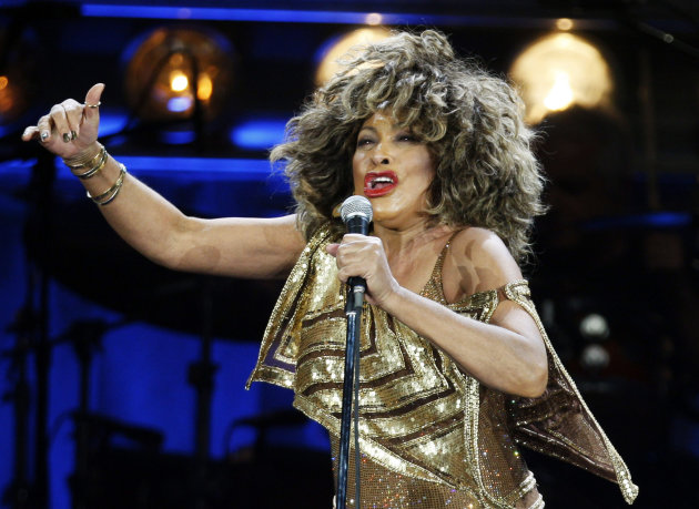 FILE - In this Sunday, Feb. 15, 2009 file photo, U.S. singer Tina Turner performs on stage during her concert at the Hallenstadion venue in Zurich, Switzerland. Tina Turner is on her way to becoming a Swiss citizen. The American rock diva has lived in the Zurich suburb of Kuesnacht since the mid-1990s. The local Zuerichsee-Zeitung newspaper said on its website the local council announced its decision to grant the 73-year-old Turner citizenship in an official notice published in the Friday, Jan. 25, 2012 edition. (AP Photo/Keystone, Steffen Schmidt, File)